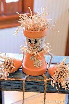 """DIY Scarecrow Flower Pot - """"A few little flower pots, a small piece of burlap (glued to the top pot), paint on a cute face, add a couple arms and legs and you've got yourself an adorable little Autumn Decor."""""""
