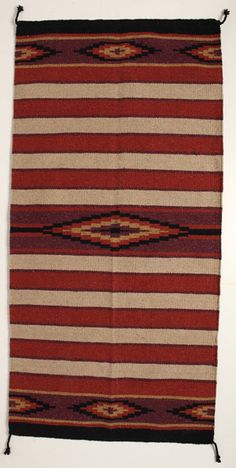 """This saddle blanket is made of quality acrylic material. Affordable style for everyday use. Measures 32"""" x 64"""". Designed, crafted, and distributed by El Paso Saddleblanket, our saddle blankets are handmade with the highest quality materials. By selling our Western tack and apparel wholesale direct, we are able to give you the best possible prices. Our saddle blankets are available in hundreds of styles. View our entire collection by clicking Saddleblankets & Pads or call us TOLL FREE at ..."""