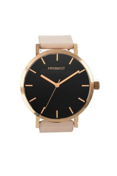 Our original inspiration behind PIPERWEST this minimalistic time will quickly become your everyday accessory. With it's clean look and rose gold / black / blush colour story.  This beautifully crafted time piece features a polished rose gold stainless steel case black face with minimalist rose gold markers and an interchangeable blush genuine leather band. Each PIPERWEST time piece is customized with logo lettering on dial and at buckle closure.    SPECS    STRAP: Genuine Italian Leather…