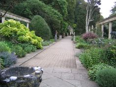 The Great Terrace of Iford Manor in Wiltshere... wide avenue (or terrace!) and great planting... good for out back?
