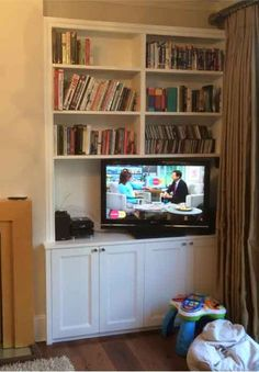 fitted alcove cupboards and tv shelf