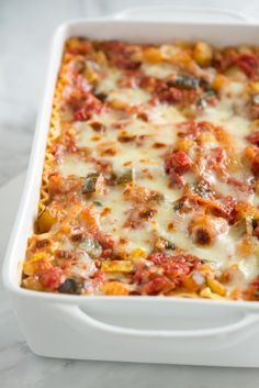 Tender vegetables, a light tomato sauce and lots of cheese make this vegetable lasagna recipe one of our favorites. From inspriedtaste.net | @inspiredtaste