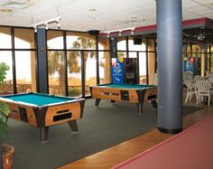 Challenge friends to a billiard game at the Beach Cove Resort.