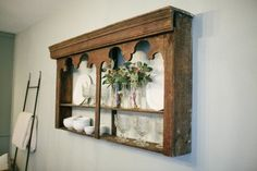 an old cabinet back acts as a shelving unit in the dining room and adds decorative storage...nice.