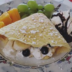 Made my blueberry and banana crepes. 😋😋😋 #breakfast #blueberry #banana #crepes #orange #grape #chocolate #whipcream #bemaifoodie