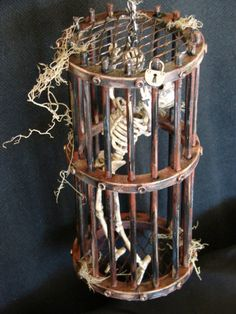 Dollhouse miniature Halloween Skeleton Torture Cage  by mechelem. Already sold on etsy but would have been cool. The blonde in the pic.