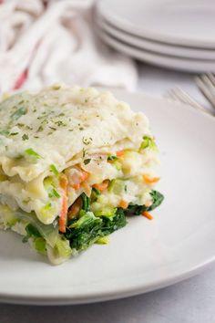 This vegan white lasagna has a luscious cauliflower sauce with veggie packed goodness!