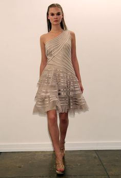 Brides.com: . Knee-length nude organza one-shoulder A-line wedding dress with a three-layered skirt and satin striped details, Tadashi Shoji