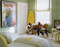 Large Disney print adds fun. Love the herringbone wallpaper & roman shade.  Yellow monogrammed bedding. Yum.
