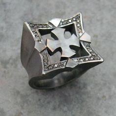 Cornered, blackened silver ring with black diamonds