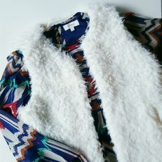 Winter Sale!!! NWT Faux Fur Vest w/ Pockets Sale Price Only Today! Amazingly soft faux fur vest with two side pockets! Perfect for this winter season!!  Brand new with tags. Last photo are photos from pinterest for outfit inspiration! Jackets & Coats Vests