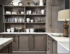 Built in hutch or open shelving in a kitchen would be really nice.I like the gray cabinets too.