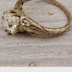 vintage wedding ring in white gold would be better!!