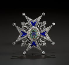 A SILVERED GOLD, DIAMOND AND ENAMEL COMMANDER'S BREAST PIN OF THE ORDER OF CHARLES III