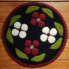 Wool applique penny rug candle mat dogwood flowers primitive
