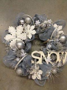 I'm thinking of using the left over tulle from the wedding…a great wreath for after Christmas.