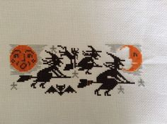 completed cross stitch Prairie Schooler Halloween witches go riding