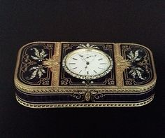 Faberge engraved gold  box with blue enamel and diamonds wit h a clock set into the lid.
