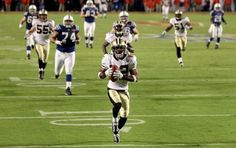 Tracy Porter returns an INT for a TD in Super Bowl XLIV. (Getty)