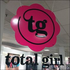 Total Girl Circular Branding by Ceiling Sign – Fixtures Close Up Total Girl, Close Up, Entrance, Mickey Mouse, Retail, Branding, Ceiling, Display, Signs
