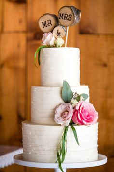 Rustic Mr. & Mrs. wooden cake topper, white wedding cake, pink florals // M. Magee Photography