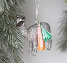 Fab ornaments!  metallic paint over your kiddos old rubber animale! donned with a tiny tassle...and taddah! for the love up upcycling (or stealing your kids' toys).