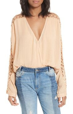 runaway blouse by Free People. Channel your most bohemian persona in this nicely draped top with openwork embroidery at the sleeves and a gathered w...