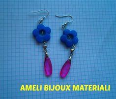 orecchini realizzati a mano con dei microcristalli viola e fiore fluo