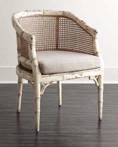 Suzie Rattan Chair at Horchow. Hand-carved and expertly distressed, this faux-bamboo chair features a double-caned rattan back and seat for a touch of tropical flair.