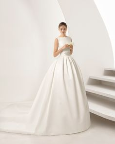 Take the plunge and go for the dress you've always dreamed of. You'll fall in love with this tailored mikado gown the moment you try it on. And you'll adore the bateau neckline and V-back! 2018 Rosa Clará Collection.