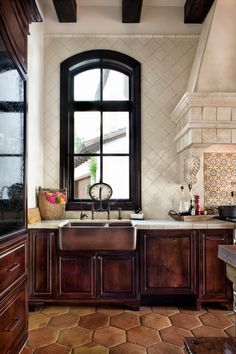 Tile walls, puffy terracotta floor tiles, copper farm sink, tall window, beautiful architectural details via: Jauregui Architecture-Interiors Spanish Kitchen Decor, Rustic Kitchen Design, Mediterranean Home Decor, Kitchen Designs, Spanish Style Homes, Spanish Colonial, Spanish Revival, Tuscan Style, Kitchen Backsplash