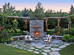 Elegant Fireside Retreat: A custom masonry fireplace is adorned with lavish plantings full of color and texture. An irregular bluestone patio made of grass joints and bluestone dust with small groundcovers provides an intimate setting to relax and take in the warmth. Tip: Outdoor fireplaces are a great... read more way to extend the season and enjoy many fall evenings by a blazing fire. It adds ambience to outdoor entertaining or creates an intimate outdoor living room for two. From…
