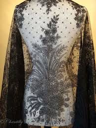 Image from http://www.chantillydreams.com/assets/images/antique-french-black-chantilly-lace-shawl-sprays-05.jpg.