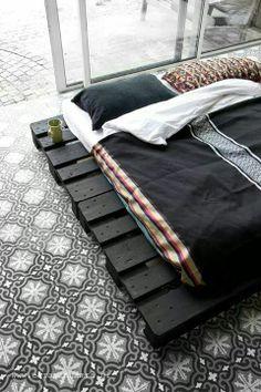 bed // wooden pallets // tiles