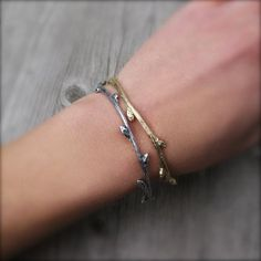 Delicate recycled-gold and silver bracelets, cast from real twigs in Denver, Colorado. #etsyjewelry