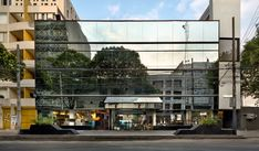 While its inner spaces have been completely overhauled, this hotel's 1980s mirrored glass facade along the street was retained.