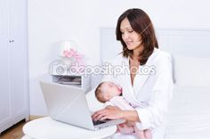 Mother with baby using laptop in room — Stockfoto #3703890