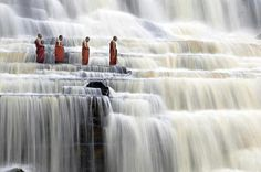 Monks at Pongour Falls in vietnam.  So cool