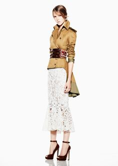 alexander mcqueen.  not sure I like the tail thing but definitely like the combination of lace and kind of military and metalic - inspirational although I probably wouldn't buy that specific jacket - as setting trends go and experimenting I personally think it's great
