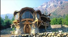 Rocks, Cob AND Logs!!! Those windows would cost quite a bit however.