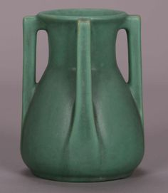 Teco matte green vase with four handles.  Signed twice.  Perfect condition.  8″h x 6″d $5500