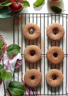 Vegan Apple Cider Baked Doughnuts recipe - Moist, tender, chock full of apple flavor and warm fall spices, coated generously with cinnamon sugar - what's not to love?! They just happen to be vegan, but you'd never know it.