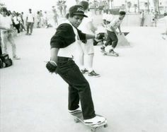 Eazy-E wearing a bulletproof vest and skateboarding at Venice Beach (1989)