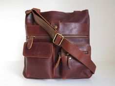 Hey, I found this really awesome Etsy listing at https://www.etsy.com/listing/126587738/leather-handbag-messenger-bag-brown