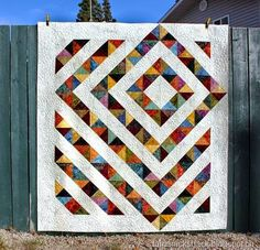 4 patch charm quilt with tutorial  from tamarack shack.