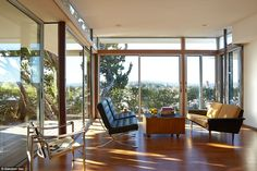 She installed floor-to-ceiling UV protective solar glass Fleetwood panels, special ordered and installed for $40,000 in the living room