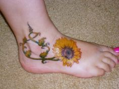 sunflower tattoo. maybe this instead of a tree frog?