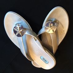 OKA.B flip flops Silver  OKA.B flip flops. Size medium. All man-made material. Made in the USA. Rubber flip-flops. Silva Sandollar with gold starfish. Never worn outside. Only in side. OKA.B Shoes Sandals
