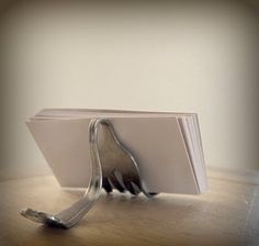 It would be great for seating name cards at a formal dinner......OMG. LOVE this business card display! It's a fork!