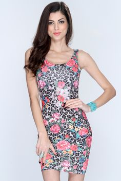 Floral print styles are so in this season. Dont be the last to trend this sweet and sassy look. Its versatile and can be worn for any special occasion. Its a must have. It features floral/animal print, scoop neck, sleeveless, and fitted. 96% Polyester 4% Spandex. Made in USA.